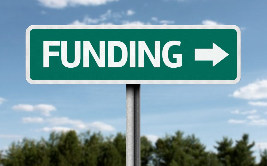 "a sign post reading ""funding"""