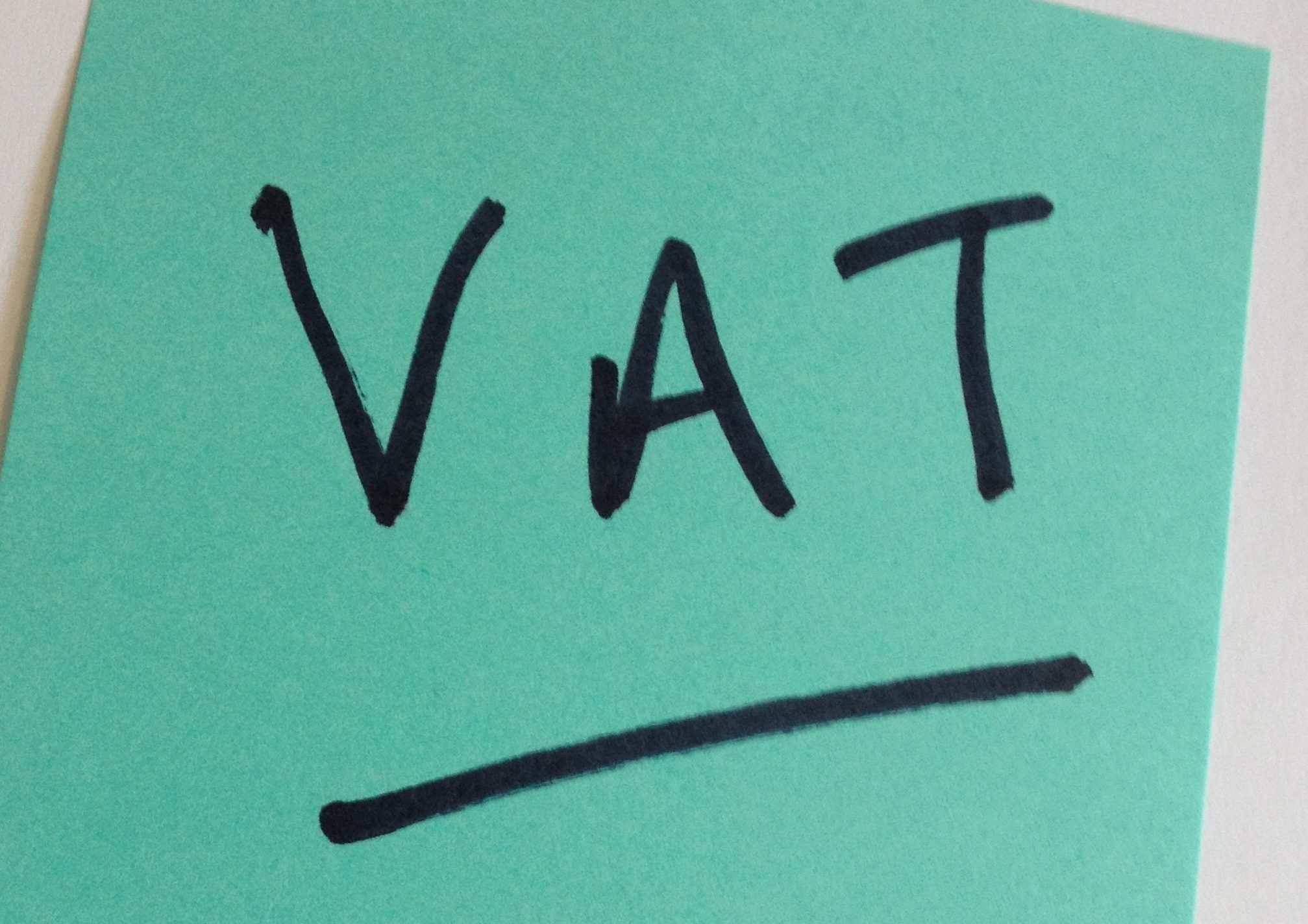 a post it with VAT written on it