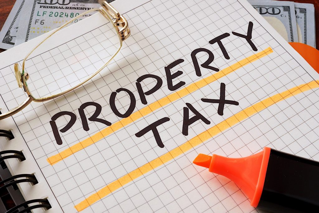 the words Property Tax written on a notepad