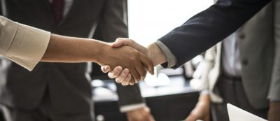 Shaking hands - Cottons Chartered Accountants